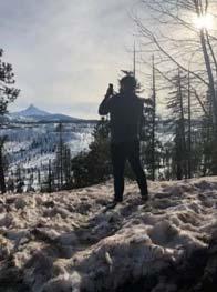 Person on Mountain taking Photo